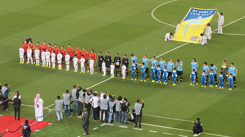 The teams line up before the kick off