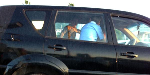 Children standing on back seat